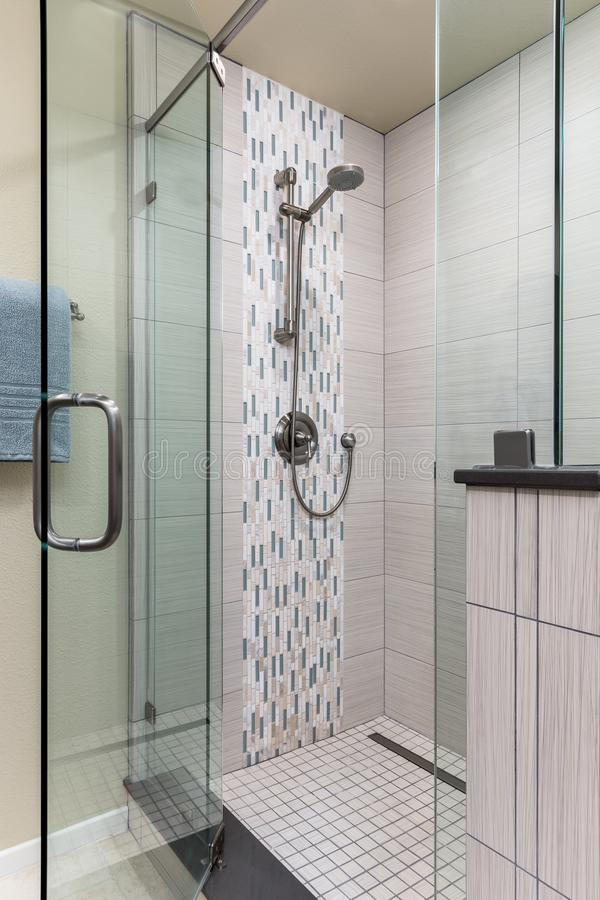 Tile shower remodel with glass door in home bathroom. Architecture, construction royalty free stock images