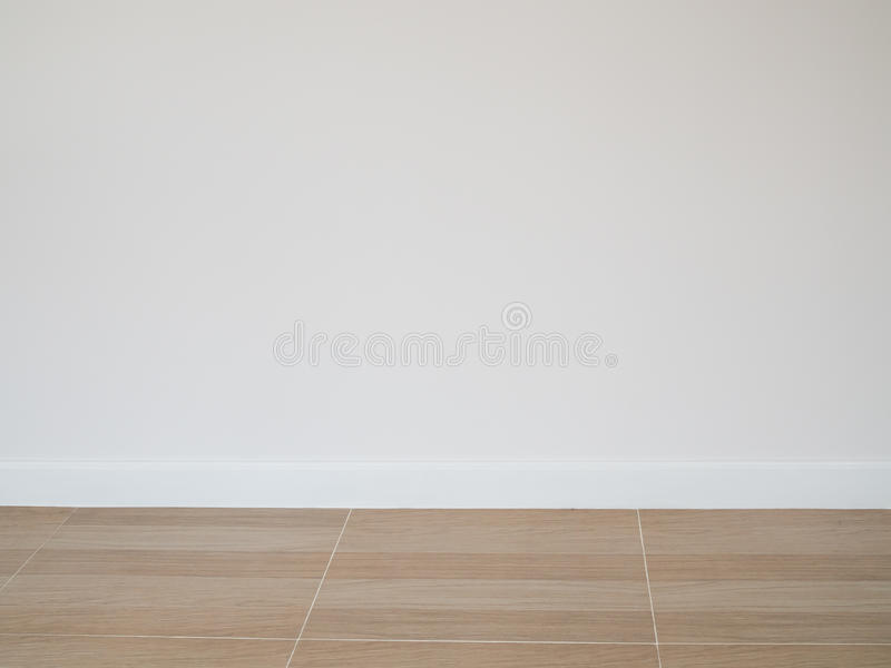 Tile wood floor pattern floor with white cement wall background stock photo