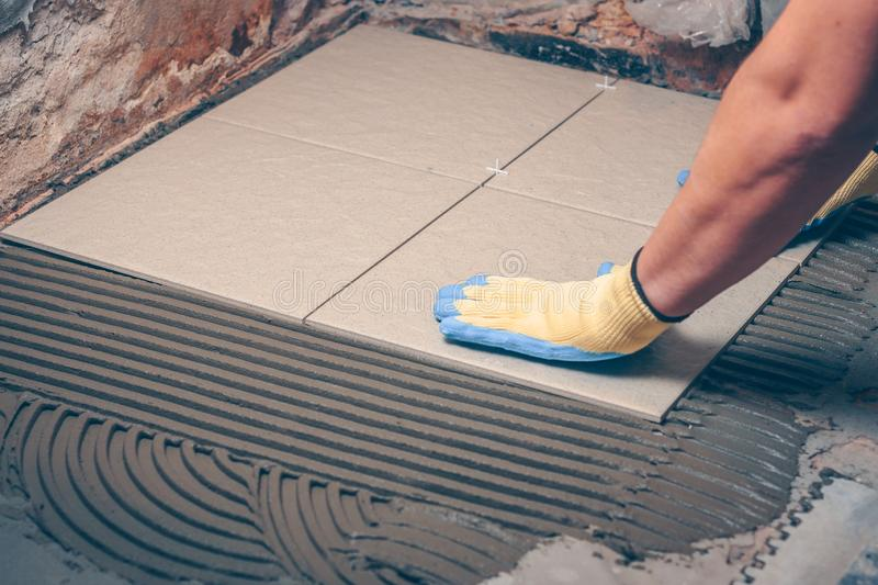 Tile works in the house - tiling royalty free stock photo