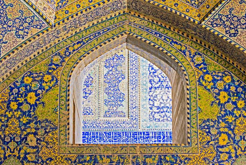 Tiled background. Oriental ornaments from Isfahan Mosque, Iran royalty free stock photos