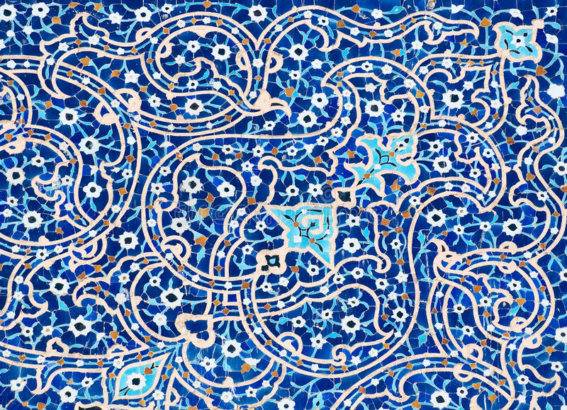 Tiled background. Oriental ornaments from Isfahan Mosque, Iran royalty free stock photo