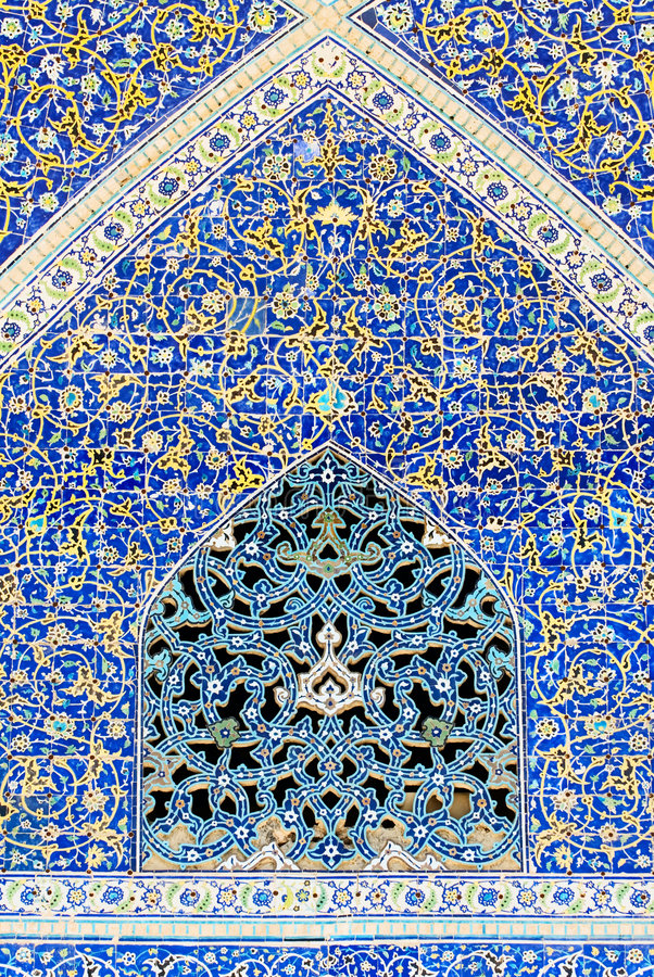 Tiled background. Oriental ornaments from Isfahan Mosque, Iran stock photo
