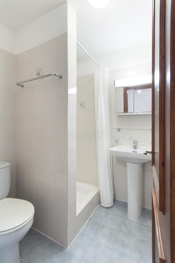 Tiled bathroom with shower , small apartment royalty free stock photo