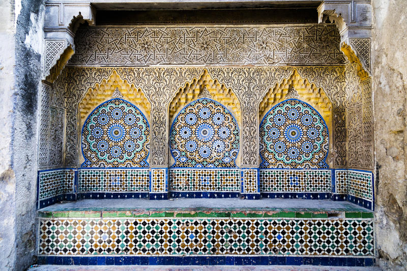 Tiled and carved alcove in Casbah, Tangier. Tiled and carved alcove in the Casbah, Tangier. Horizontal format royalty free stock photo