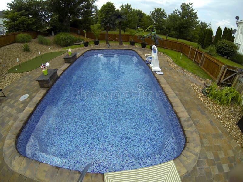 Tiled fiberglass pool. Tiled fiberglass swimming pool, paver patio, Landscaping royalty free stock photography