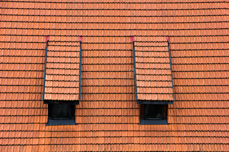 Tiled garret roof. Architectural textured background stock photo