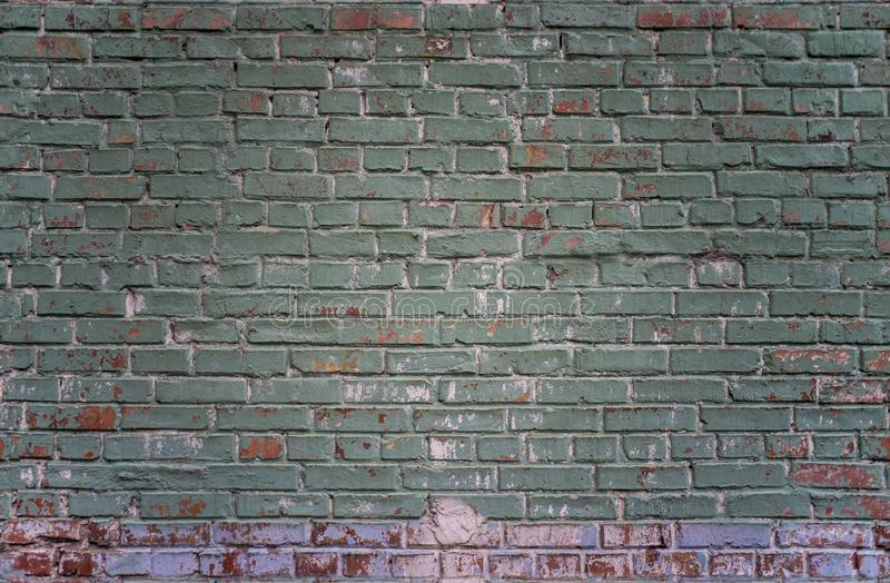 Tiled grunge industrial green and red brick wall background in Kyiv, Ukraine. royalty free stock image