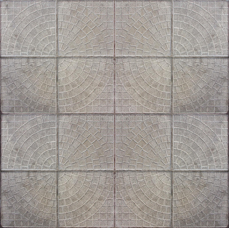 Tiled mosaic concrete pavement. Of the road stock photos