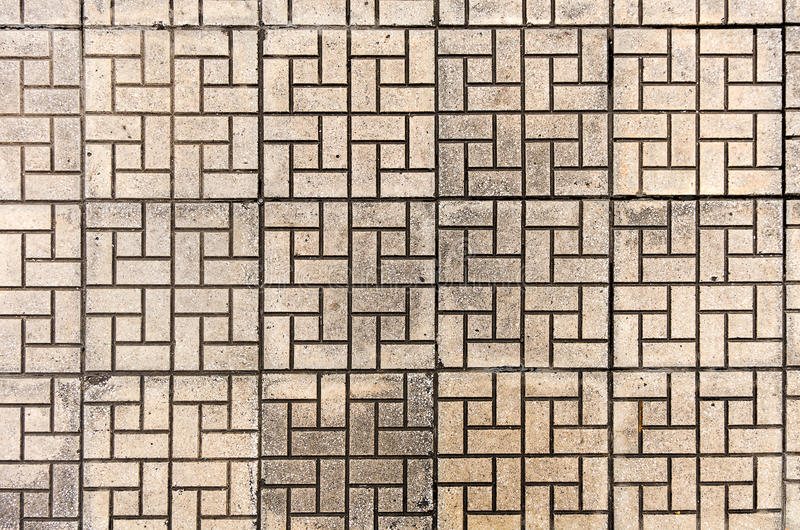 Tiled mosaic concrete pavement of the roadม Seamless texture of paving stones. Brow tile background. Tiled mosaic concrete pavement of the road royalty free stock photography