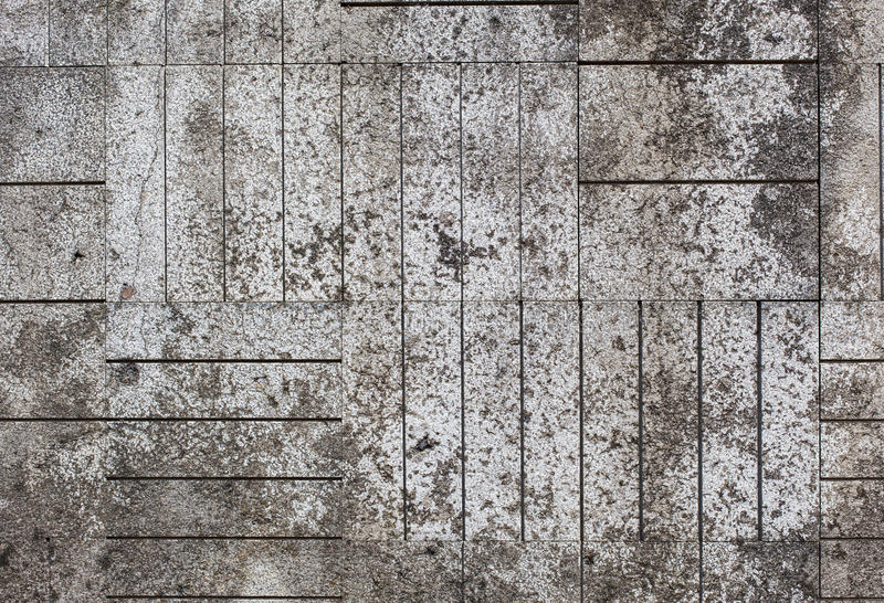 Tiled mosaic concrete pavement of the road.  stock image