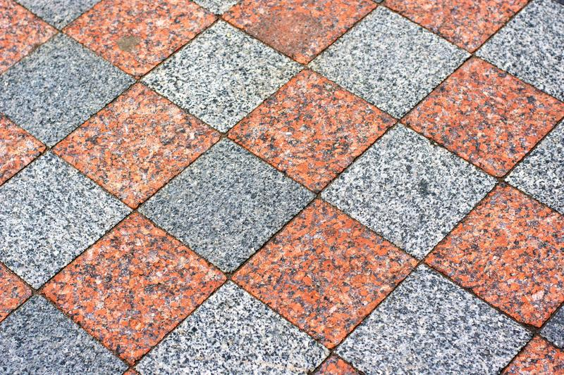 Tiled mosaic concrete pavement of the road background. Tiled mosaic geormetry concrete pavement of the road background royalty free stock photo
