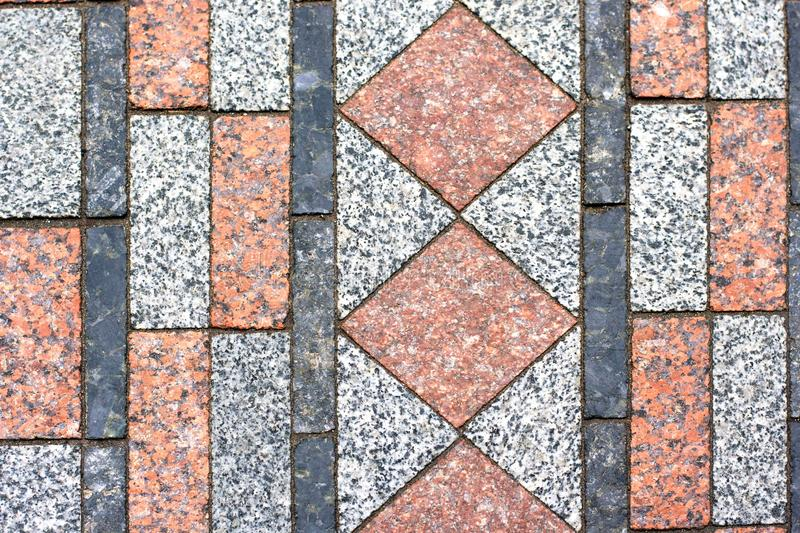Tiled mosaic concrete pavement of the road background. Tiled mosaic geormetry concrete pavement of the road background royalty free stock photos