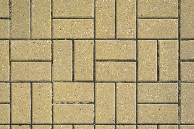 Tiled mosaic concrete pavement of the road. Pavement Texture royalty free stock image