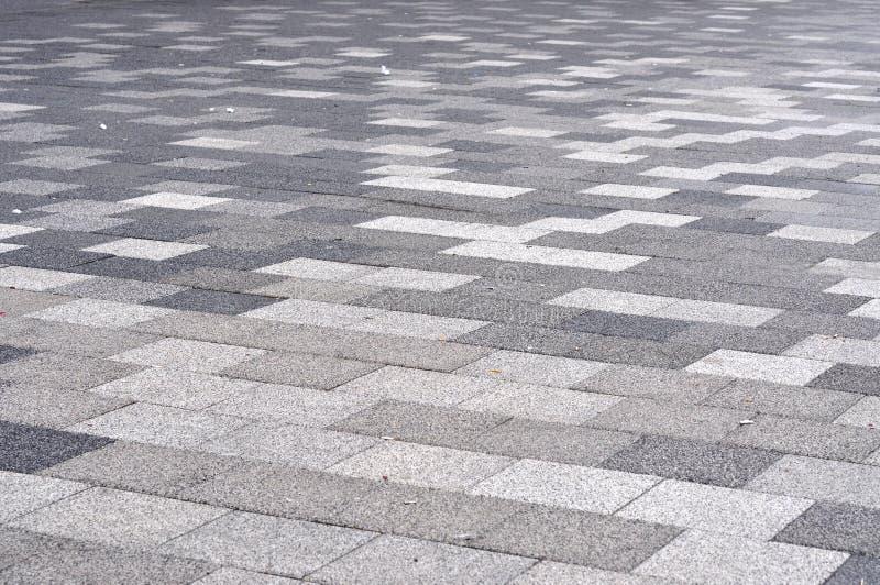 Tiled mosaic concrete pavement. On the street stock photos
