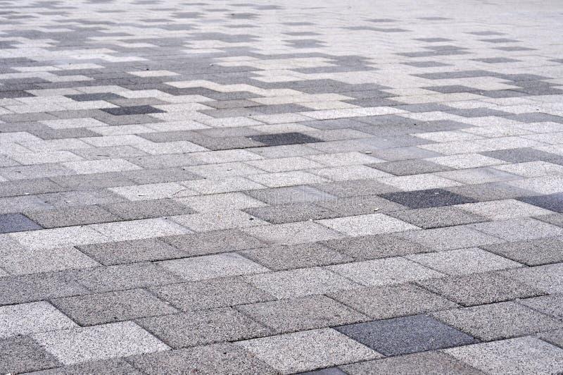 Tiled mosaic concrete pavement. On the street stock photo