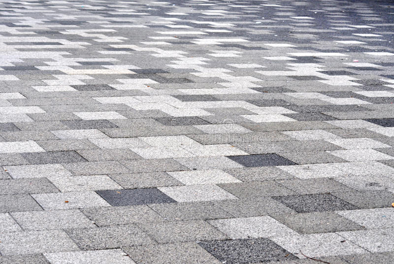 Tiled mosaic concrete pavement. On the street stock images