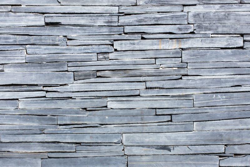 Tiled mosaic concrete pavement. A texture wallpaper royalty free stock photo