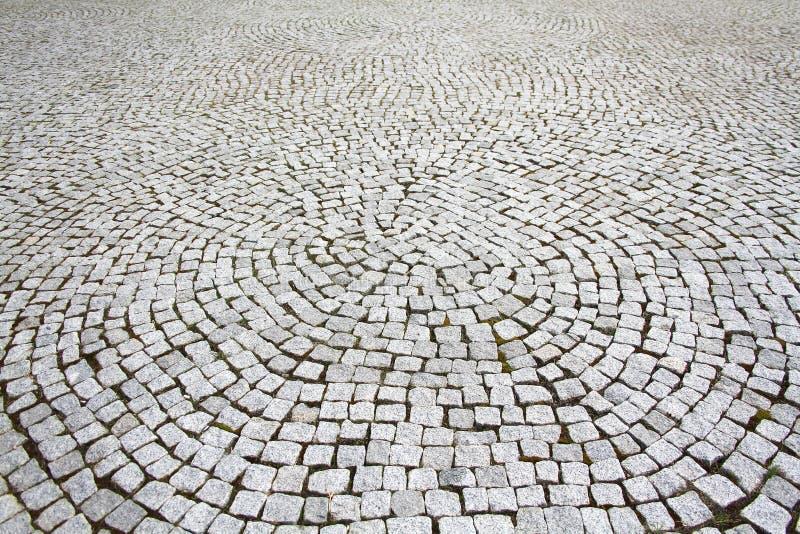Tiled pavement background. Circle paving stock image