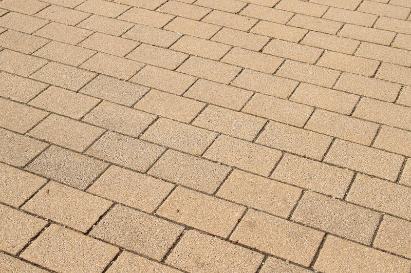 Tiled pavement. Background and texture of tiled street, tiled walkway, grey pavement royalty free stock photography