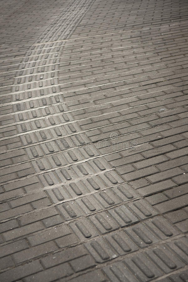 Tiled pavement in China. Backgrounnd of tiled pavement in China. The pattern is ued by blind people to find their way stock images