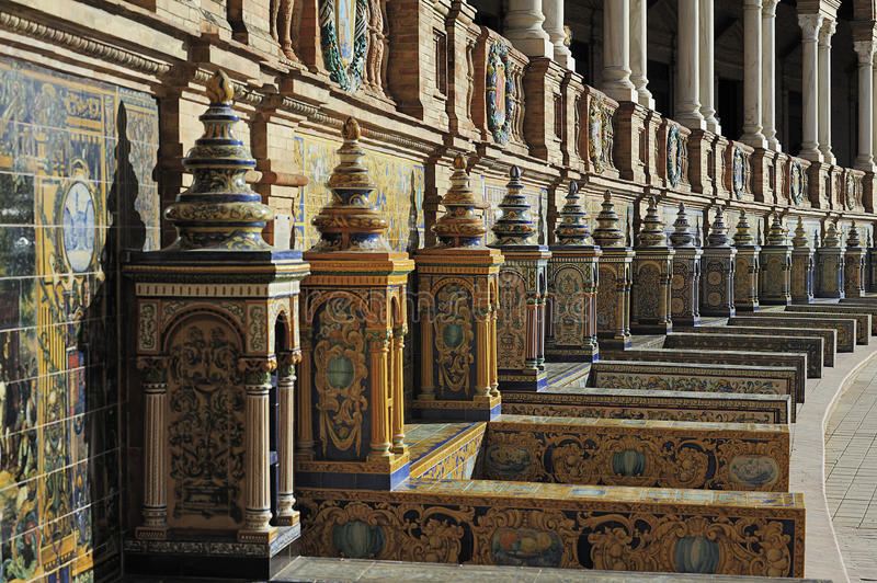 The Plaza de Espana (Spain Square), Seville, Spain. Tiled Province Alcoves at the Plaza de Espana (Spain Square), Seville, Spain royalty free stock photography