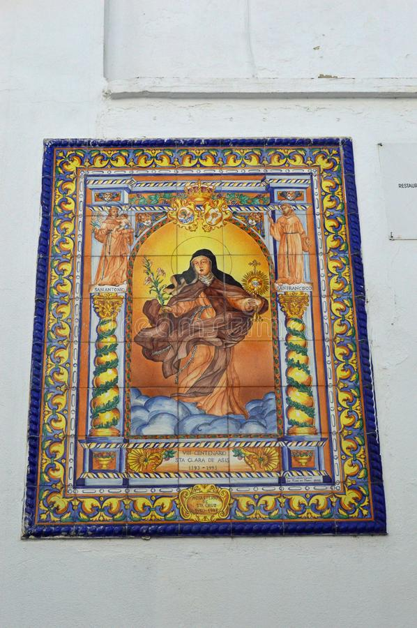 Tiled religious painting architectural detail on a white building in Cordoba Spain royalty free stock photo