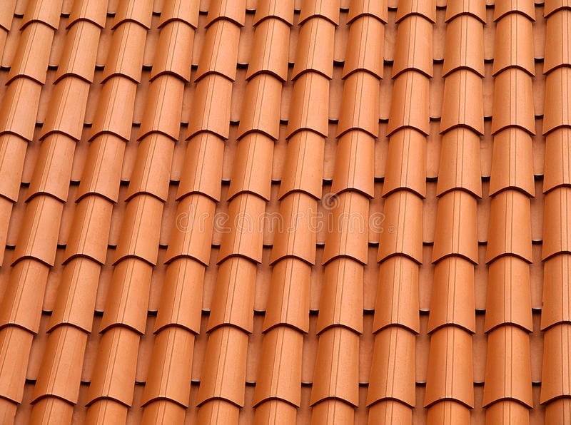 Tiled roof. Traditional orange clay roofing tiles stock photos