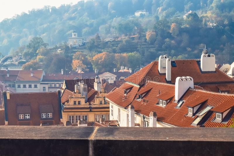 Tiled roofs of old houses in the autumn morning in Prague. Tiled roofs of old houses in autumn morning in Prague, architecture, autumnal, blue, building royalty free stock photography