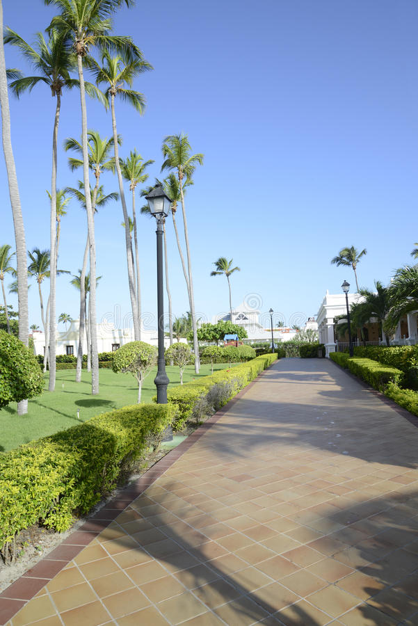 Tiled walkway at a tropical resort stock images