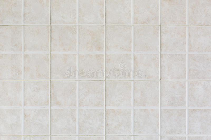Tiled wall texture background. Tiled beige wall texture background royalty free stock photo