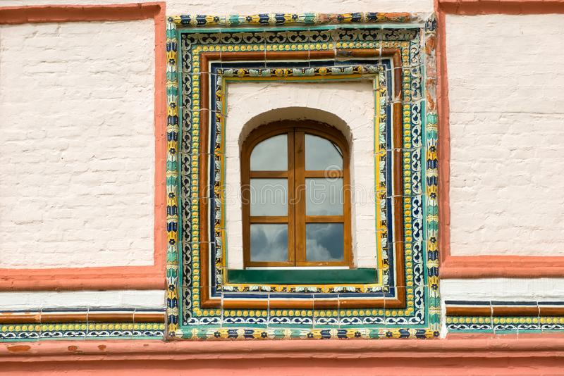 Tiled window trim on the east side of the Priory Corpus royalty free stock photo