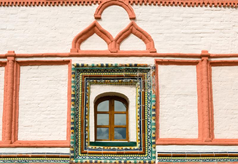 Tiled window trim on the east side of the Priory Corpus. Valdai Iversky Svyatoozersky Virgin Monastery for Men. Selvitsky Island, Valdai Lake stock photo