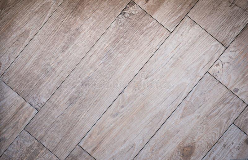 Tiled wood board floor - wooden parquet tiles / laminate stock images