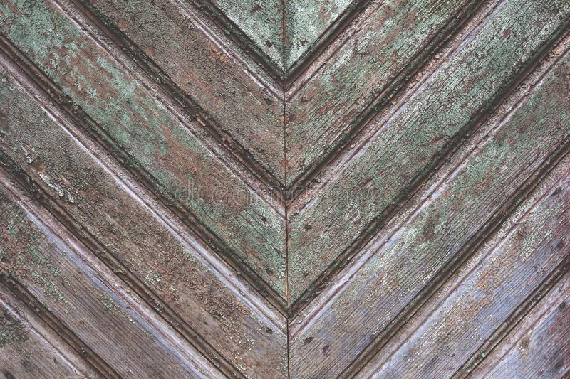 Old and aged wooden textured background. Tiled Wooden Wall Planking Horizontal Texture. Old Rustic Wood Slats Shabby Background With Herringbone Pattern. Peeled royalty free stock photography