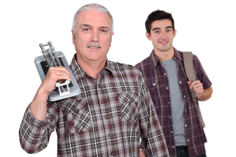 Tiler and trainee. Tiler astood with a young trainee royalty free stock photography