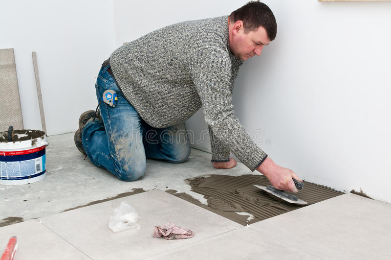 Tiler at work stock photography