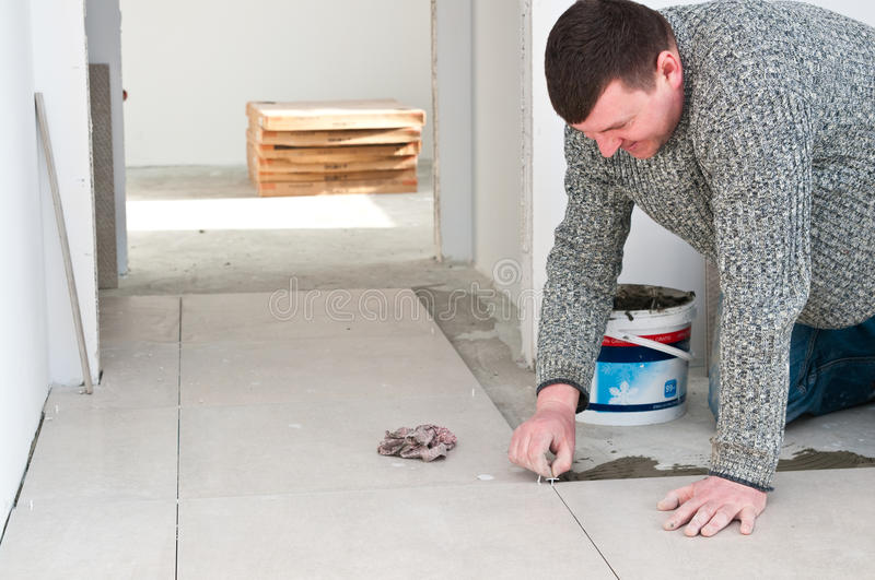 Tiler at work stock photos