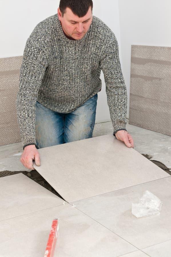 Tiler at work royalty free stock image