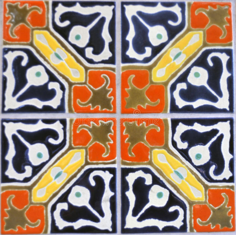 Tiles. Four square tiles with curves of color in blue orange yellow brown and green, abstract shapes and lines in no particular order but balanced in four stock photos