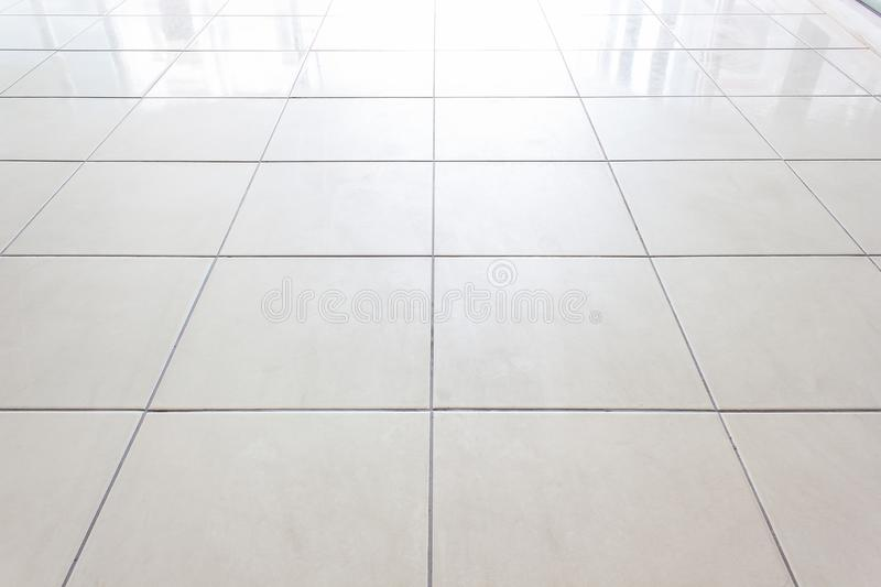 Tiles marble floor background/White tiles floor texture office With the morning sun, the windows reflect the reflection. Tiles marble floor /White tiles floor royalty free stock images