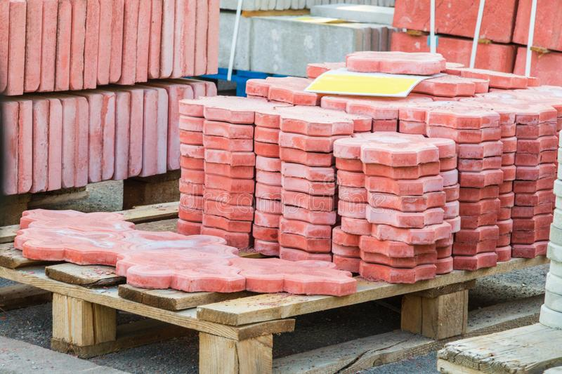 Tiles piled in pallets, warehouse paving slabs in the factory for its production. Red tiles piled in pallets, warehouse paving slabs in the factory for its royalty free stock photography