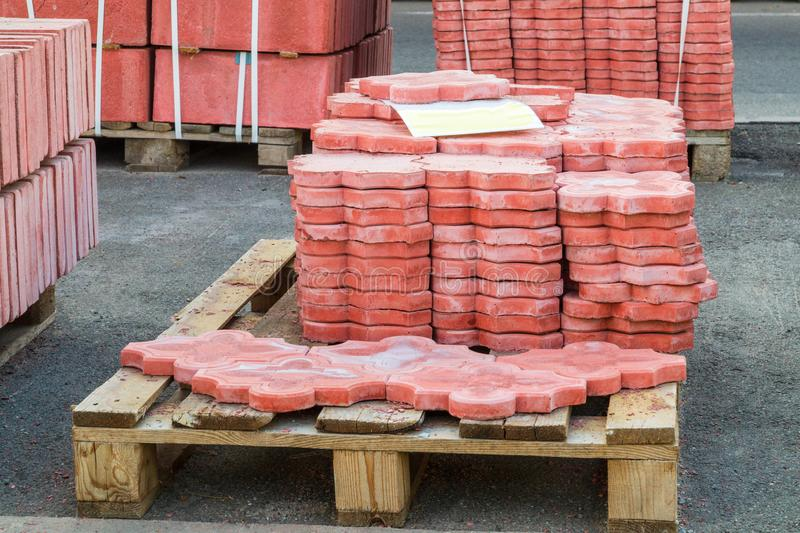 Tiles piled in pallets, warehouse paving slabs in the factory for its production. Red tiles piled in pallets, warehouse paving slabs in the factory for its stock images