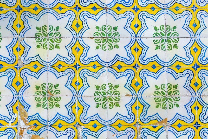 Tiles of Portugal. Ceramics - old square blue, white, green and yellow tiles of Portugal stock photo