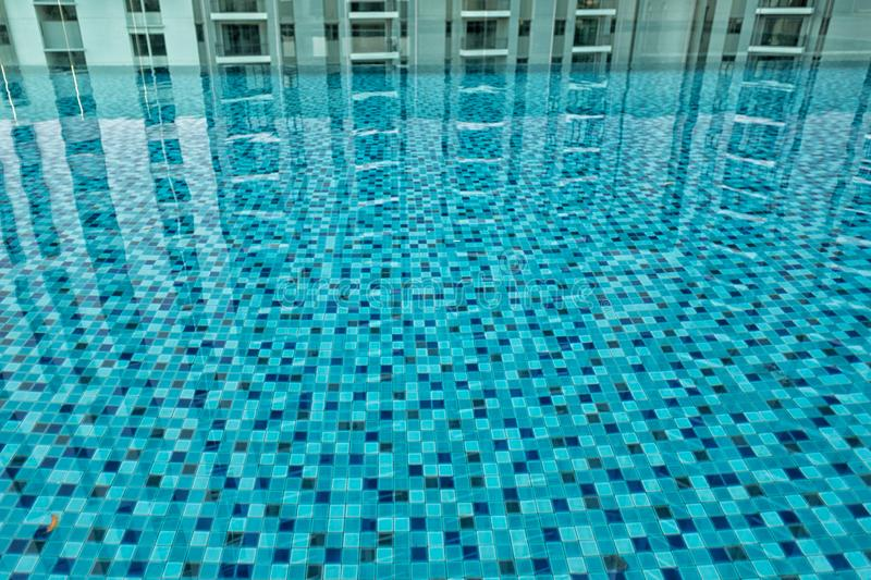Tiles and reflections of a swimming pool. Abstract view if blue patterned tiles and reflections of a swimming pool royalty free stock photography