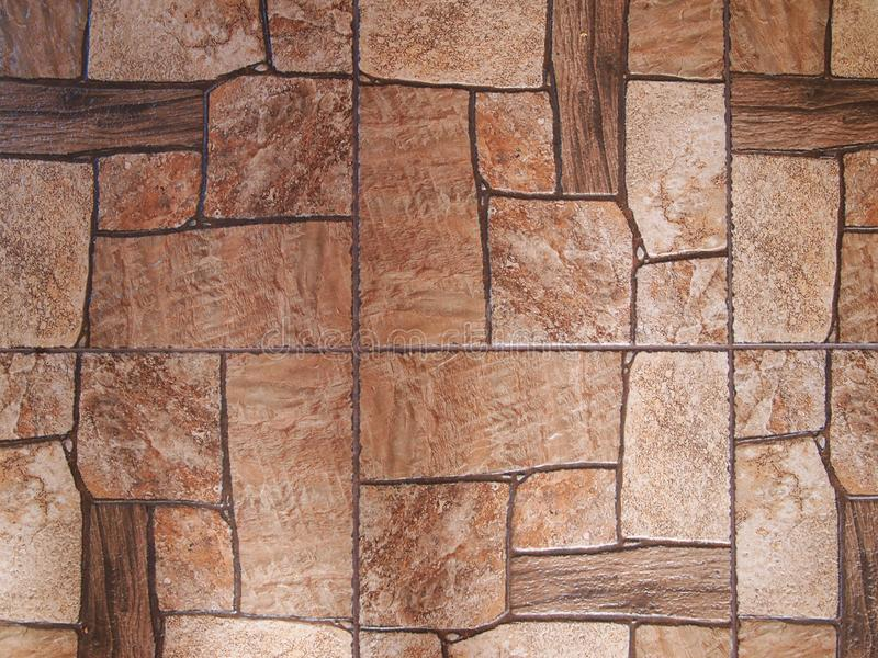 Tiles, stylized as an old cobblestone pavement. Light brown and dark brown tones. stock photography