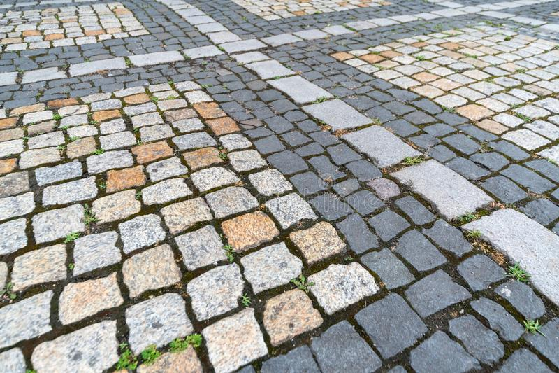 Tiles texture. Pattern of ancient german cobblestone in city downtown. Little granite paving stones. Antique gray pavements royalty free stock images