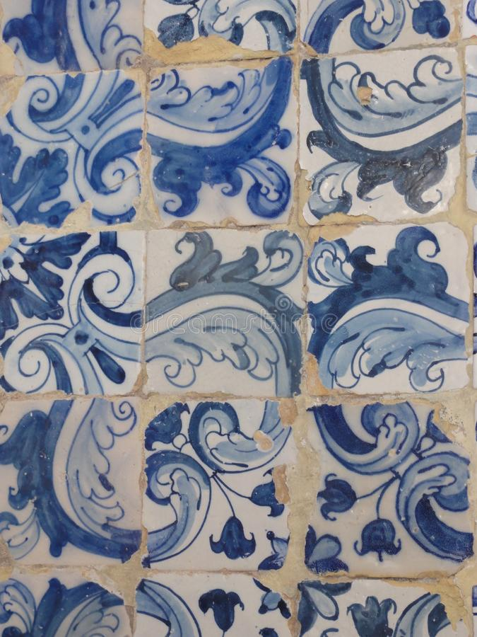 Tiling azulejo - Portugal. An azulejo or azuléjo1 plural: azulejos indicatesappoints in Spain and in Portugal a tilewindow pane or a set of decorated stock image