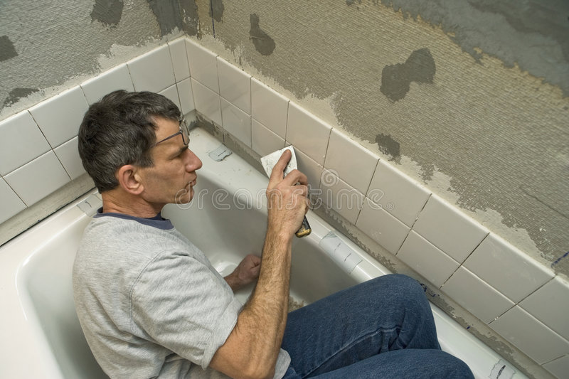 Tiling the Bathroom stock photography
