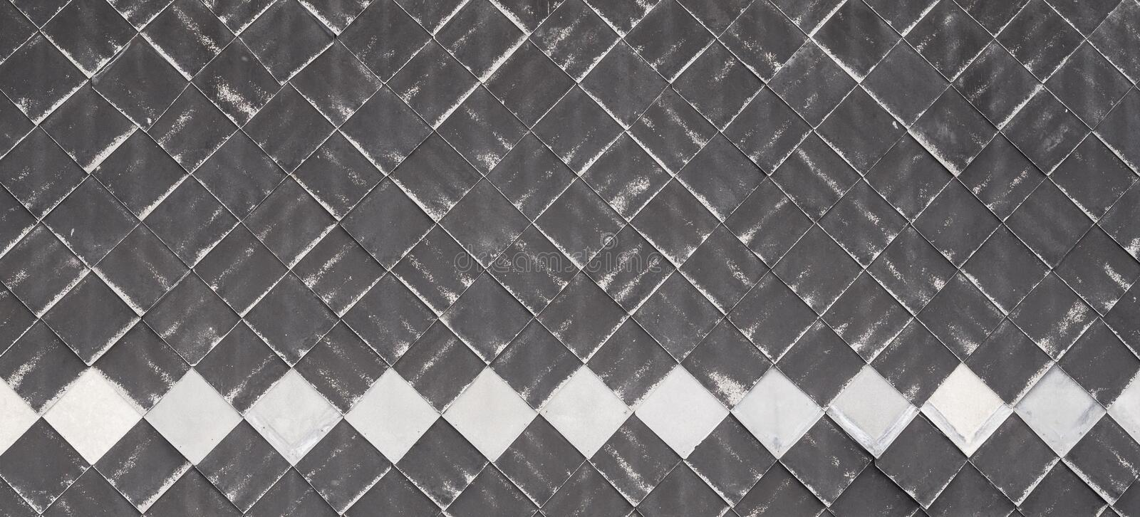 Tiling of wall with plastic material. Old weathered. texture background royalty free stock photo