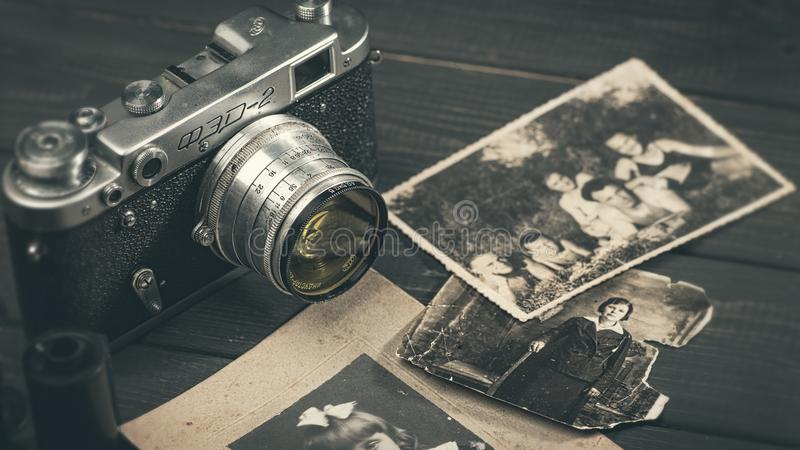 Till life with retro soviet photo camera FED-2. October 23, 2017, Kiev, Ukraine. Still life with retro soviet photo camera FED-2 and lens Industar over wooden royalty free stock image